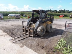 Skid Steer  1999 New Holland LX865 , 76 HP