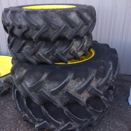 John Deere Fronts are 12.4-24. Wheel and tire Rears are 18.4- Attachment For Sale
